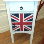 "A cute little side table in any bedroom or use it as a cool one of a kind side table by your sofa. The Union Jack has been hand painted on and distressed for a very ""rock and roll"" look Reg: $150 Sale: $75"